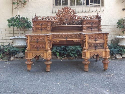 A Profusely Ornately Carved Victorian Desk In The Baroque Style With Parquetry Inlaid Top