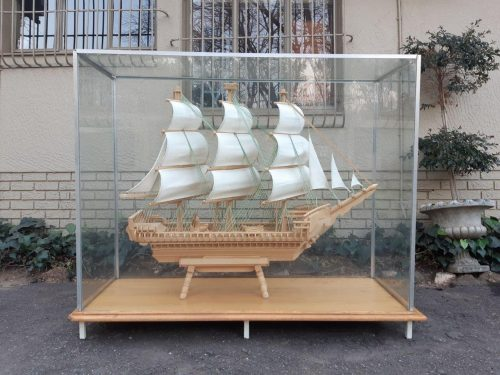 HAND CARVED MODEL SHIP IN GLASS DISPLAY BOX