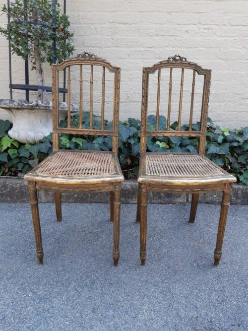 Pair of 19th Century Wooden Carved and Gilt Side Chairs with Rattan Seats