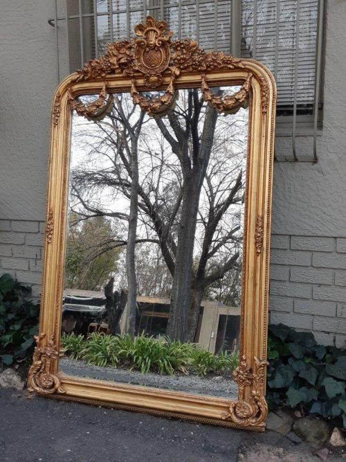 An Ornate and of Large Proportion Giltwood Bevelled Mirror  - ND