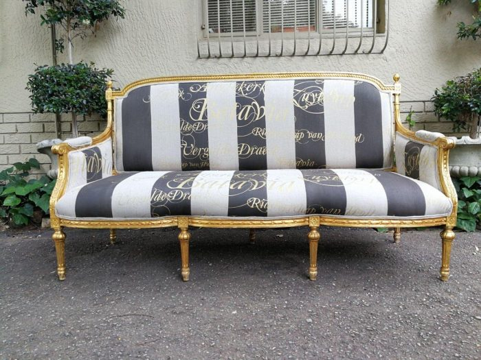 A French Antique Hand -Carved And  Gilded  Settee Upholstered In An Imported English Linen