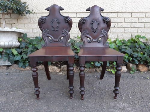A Pair Of Victorian Mahogany & Stained Oakwood Cartouche Back Hall Chairs