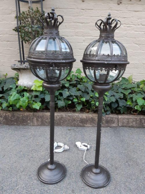 Pair of bronzed finish painted lamps with crown detail