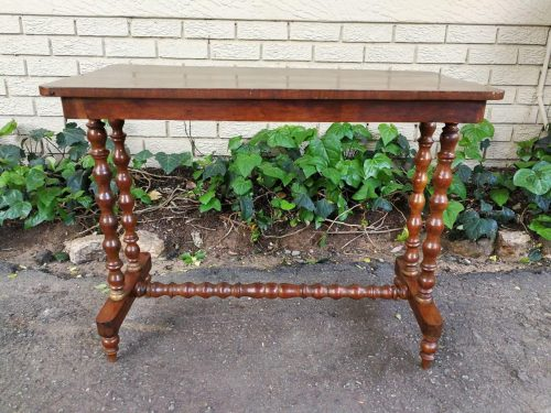 A Victorian Mahogany And Inlaid Stretcher Table