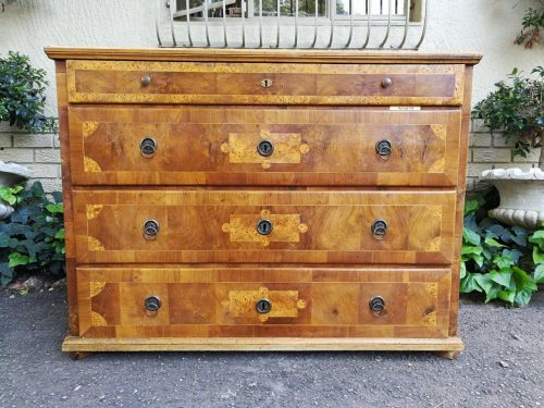 A Walnut And Inlaid Chest-Of-Drawers