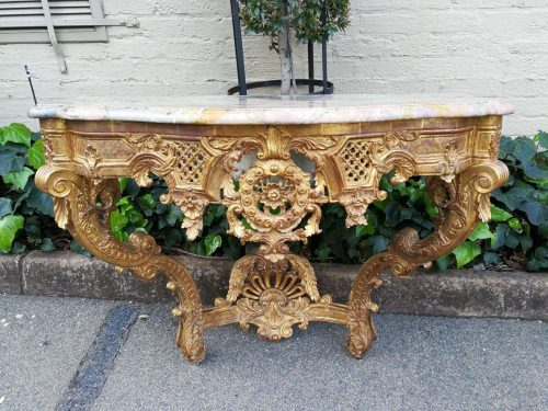 A Giltwood And Marble-Topped Console Table