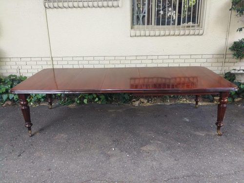 A Large Antique Victorian Table On Casters