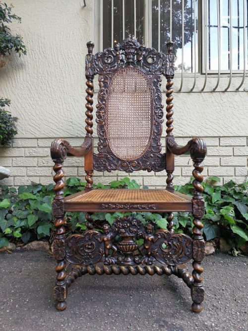 19th Century Ornately Carved Flemish Throne Chair With Rattan Back And Seat