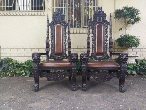 A Very Large Pair Of Heavily Carved Spanish Throne/King And Queen Chairs Covered In Leather