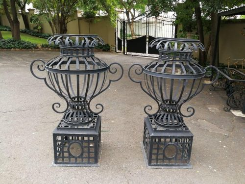 A Pair Of Large Proportion French Cast Iron Lattice Urns