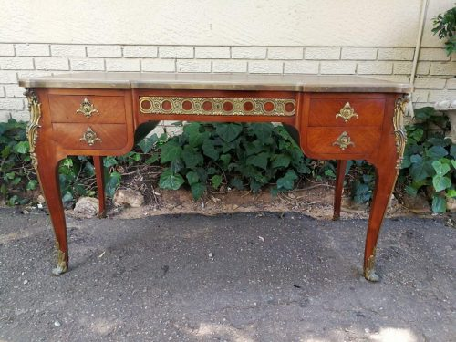 A Late 19th Century French Kingwood Mahogany And Gilt-Metal-Mounted Bureau Plat With A Red Leather Writing Surface