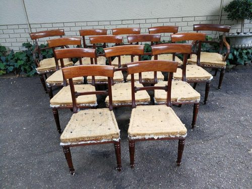 A Victorian Set Of Fourteen (14) Mahogany Dining Chairs