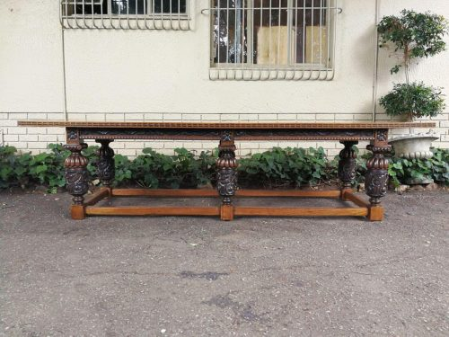 An Antique English Carved Oak Refectory Table Of Large Proportion. Circa 1870