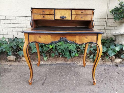 A 19th Century French Walnut Writing Desk With Leather Inlaid Writing Surface