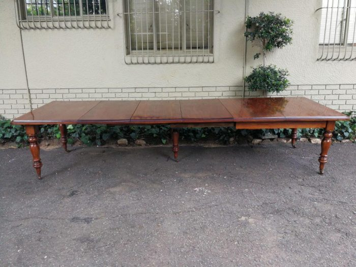 A Victorian Mahogany Extending Dining Table Of Very Large Proportion Nearly 4 Meters Extended On Five Carved Legs And Castors Nd