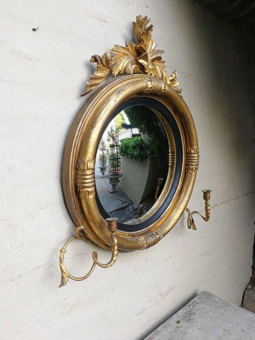 A 19th Century Regency Style Convex Giltwood Mirror