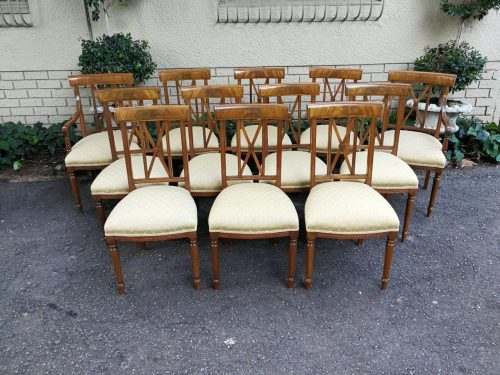 A Set Of Twelve George Iii Style Mahogany Dining Chairs Comprising Of Ten Chairs And Two Carvers