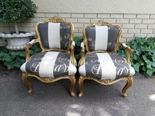 A Pair Of Carved And Gilded French Louis Xv Chairs