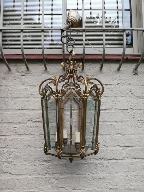 A Brass And Engraved Glass Four Light Lantern