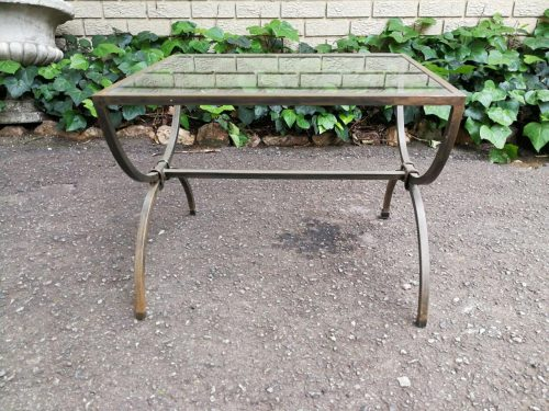 A Wrought Iron Side Table With Glass Top