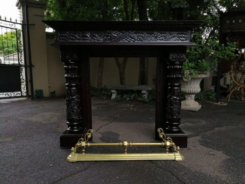 Hand-Carved Wooden Fireplace Mantle With Brass Surround