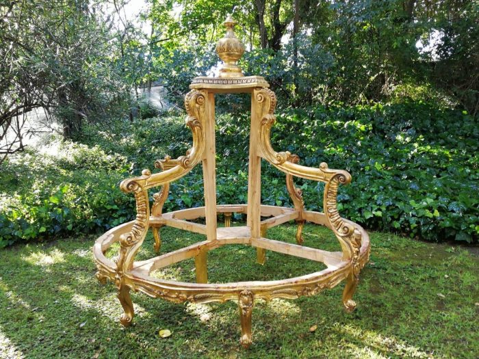 A French Style Carved Wooden Conversation Settee Of Large Proportion