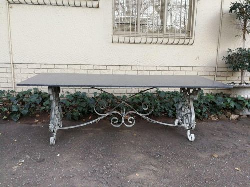 A Custom-Made And Heavy Wrought Iron Table Base Of Large Proportion With Honed Granite Top