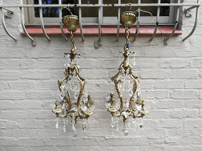 A Pair Rococo Style Crystal And Bronze Chandeliers