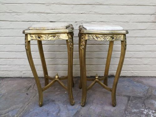 A pair of gilded occasional/ side tables with marble tops