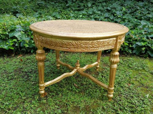 An Ornately Carved Rattan Table