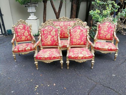 A Five Piece Ornately Carved And Gilded Set Comprising Of A Gilded Settee And Four Large Size Armchairs *Still To Be Reupholstered*