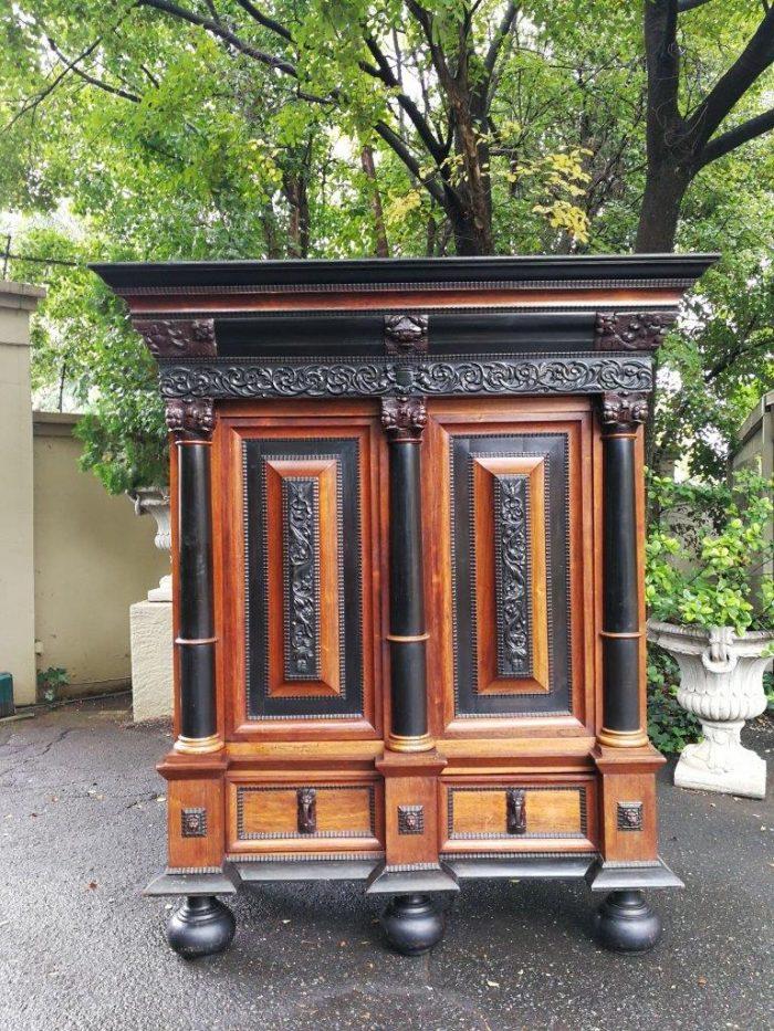 A 19th century extremely large Dutch heavily carved oak and ebony kussingkas/ kussenkast cabinet