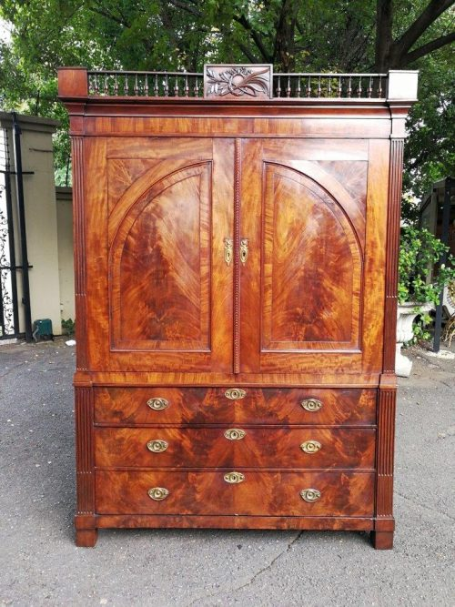 A Late Georgian Linen Press in Flame Mahogany with a Gallery Ornate Crown Circa 1780s