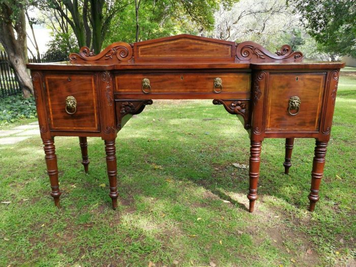 A 19th century mahogany server with inlay with an area for alcohol/champagne/wine