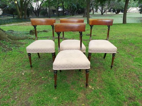 A set of four Victorian mahogany dining chairs