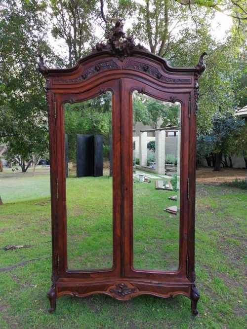 A 19th Century carved mahogany armoire