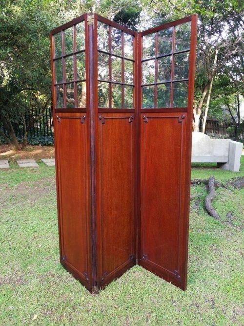 A Late 19th century mahogany three-panel screen