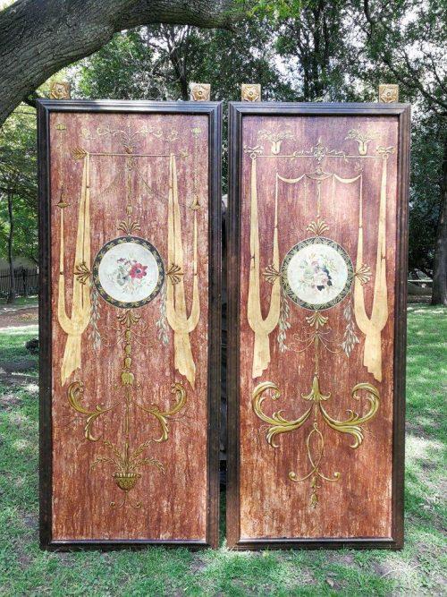 A 20th century pair of wooden painted wall panels