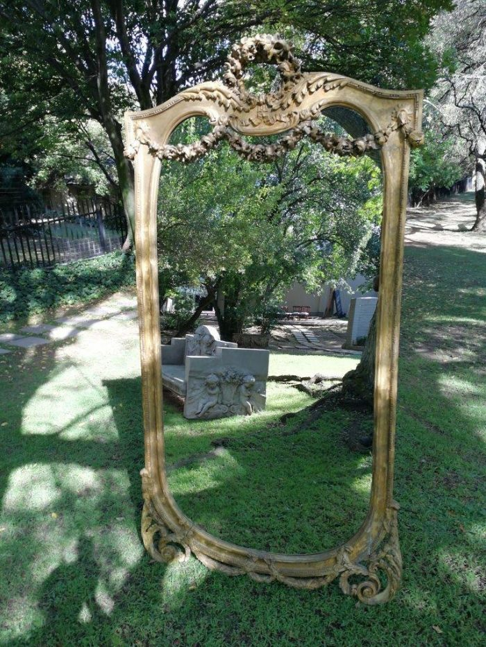 Massive gilded wall mirror