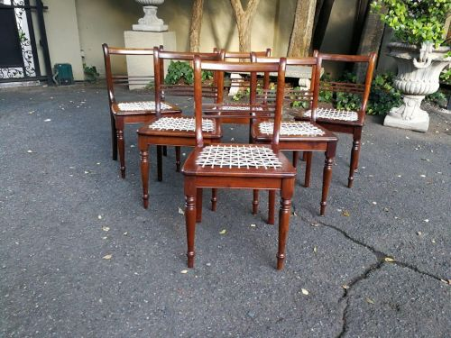 A ser of six Cape Regency style Riempie chairs