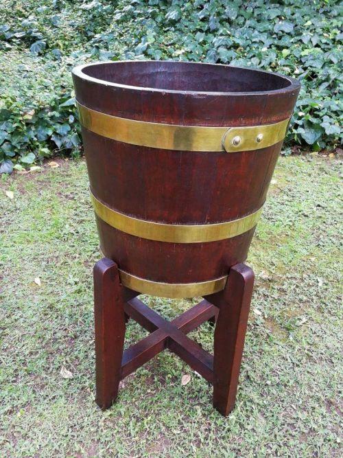 A 19th century Cape teak brass-bound balie on stand