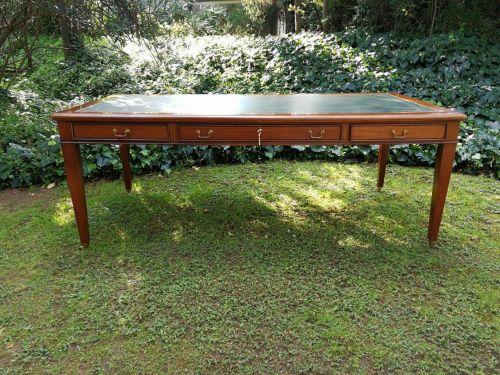 A Victorian style large mahogany desk on castors