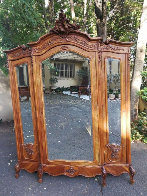 An Antique French Walnut Carved Rococo Style Three Door Armoire
