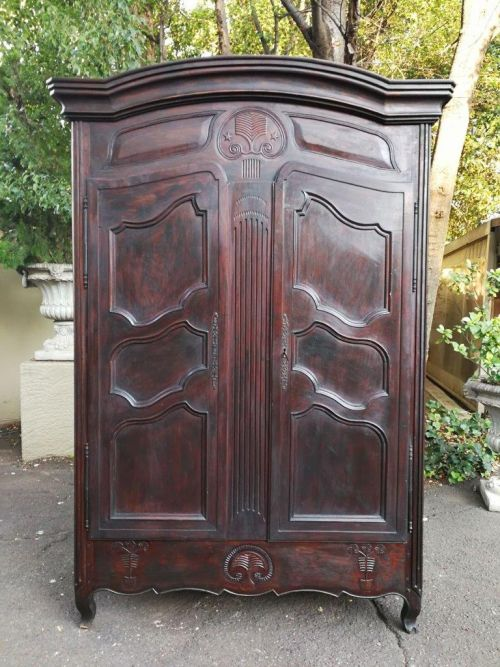 An 18th Century/early 19th Century French Walnut Dauphinoise armoire from the North of Lyon which has both Louis XV and Louis XVI elements