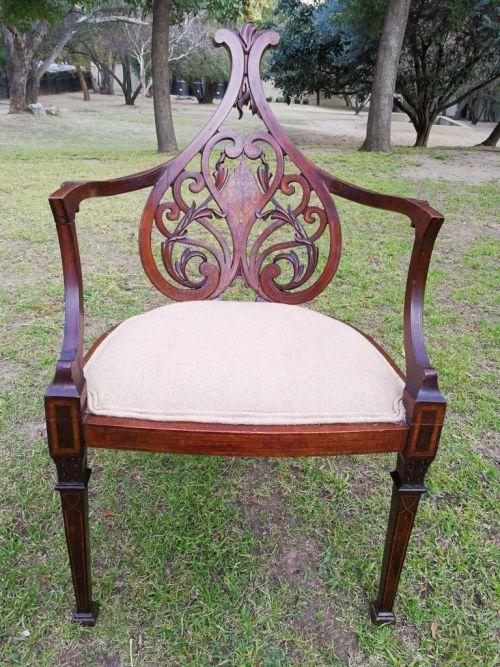A Victorian Inlaid Mahogany Armchair