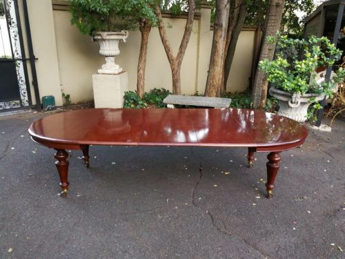 A Victorian Mahogany Extension Dining Table On Castors
