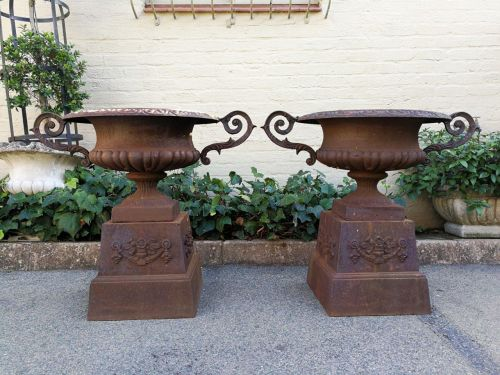 Pair of French style cast iron decorative urns/garden pots/urns on cast iron bases