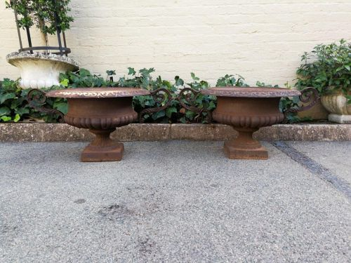 Pair of French style cast iron decorative urns/garden pots/urns