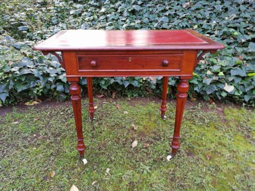 Victorian library table with red leather and gilt tooled surface