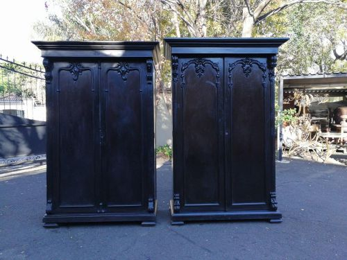 A rare near pair of 19th century Anglo Indian ebonised teak wood armoires / cupboards / linen presses